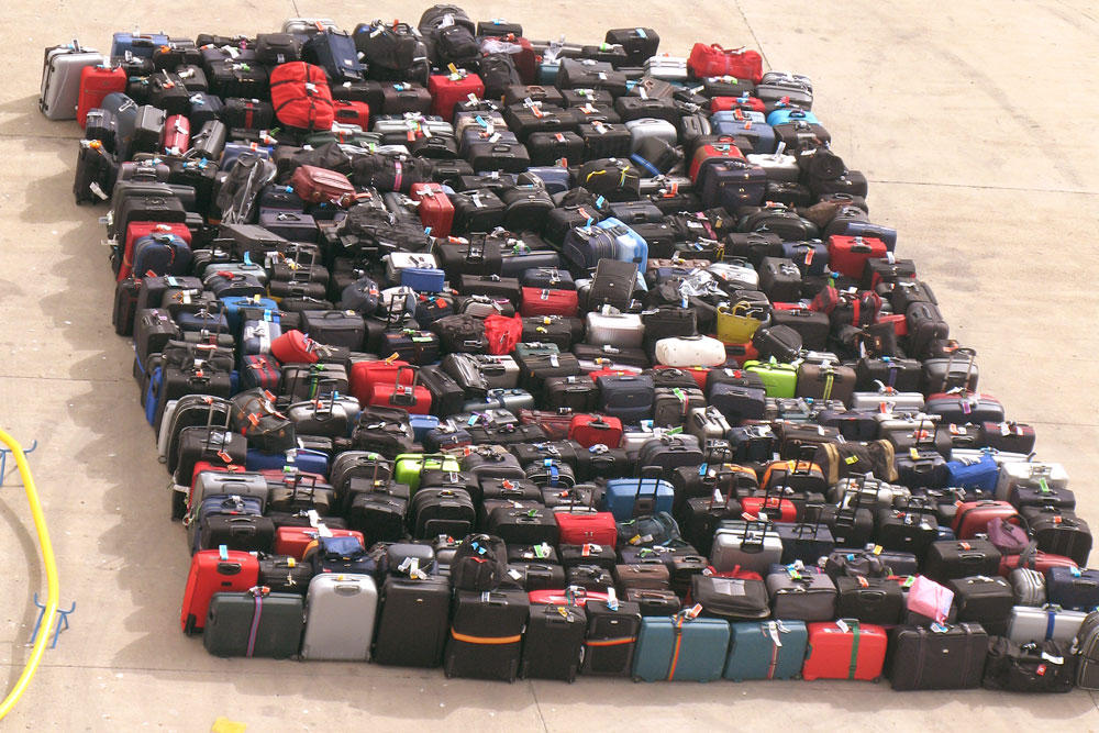 Upper view of organized luggage at airport arrival